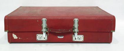 Revelation red bound suitcase