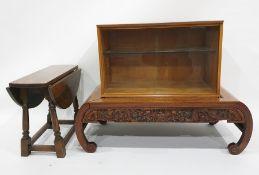 Eastern low coffee table anda teak cabinetwith sliding glass doors (2)