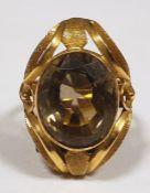 Gold coloured metal and smokey quartz dress ring