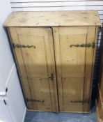 Late 19th/early 20th century pine two-door cupboard, the doors opening to reveal shelves, 83.5cm x
