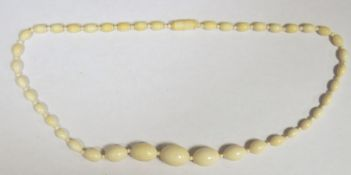Ivory bead necklace, graduated, oval beads with spacers, 54cm long