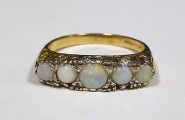 Five stone opal 9 ct gold dress ring