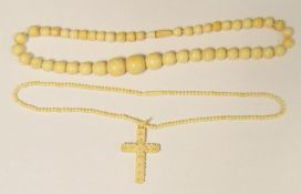 Bone necklace, graduated beads and an ivory-coloured crucifix pendantwith necklace
