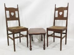 Pair of oak chairswith rush seats and a walnut coffee table(probably originally part of a whatnot)