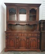 20th century pine dresserwith two doors above open recess and base of three drawers, three cupboard