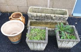 Two rectangular moulded concrete planters in the form of drystone walls, two tapered square