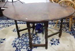 20th century oak oval gateleg dining table on turned and block supports, stretchered base