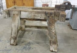 Substantial wooden workbench with attached engineer's vice, 110cm x 50cm