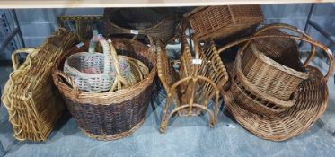 Various baskets including a wicker magazine rack, picnic basket, log basket and others, etc