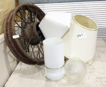 A vintage cast iron wheel, pair of bedside lamps, a pair of small brass coloured table lamps, a