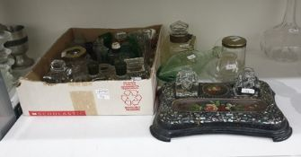 Collection of glass and metal-mounted inkwells, various medical bottles, an eye bath, a measuring