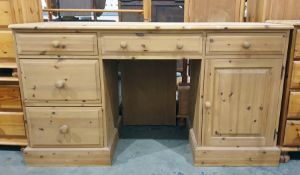 20th century pine dressing table with assorted drawers and cupboard doors, the whole raised upon a
