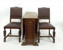 20th century oak drop-leaf dining tableand four oak and brown leather chairs(5)