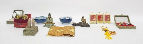 Two Chinese figurines one with water buffalo and boy sitting  astride and a collection of boxed