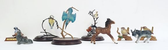 Beswick model of a foal together with a continental German pottery model donkey, a German pottery