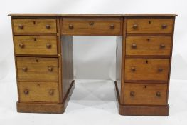 19th century mahogany breakfront deskwith nine assorted drawers, raised upon plinth base, 122cm x