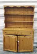 Pine dresserwith open shelves above two drawers and two cupboard doors