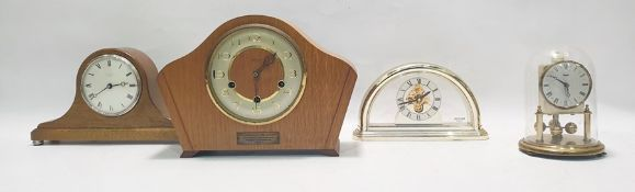 Modern quartz mantel clockwith visible movement, a small Kundo anniversary clockand two other