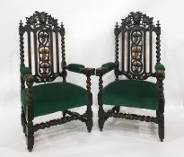 Pair of Victorian oak armchairsin the Gothic-taste, the top rail with green mask, backsplat