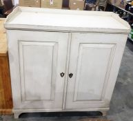 Cream painted 19th century cupboard, the rectangular top three-quarter galleried above two