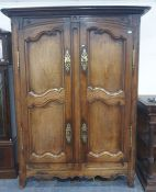 French armoirewith two doors enclosing hanging space, brass escutcheons and hinges