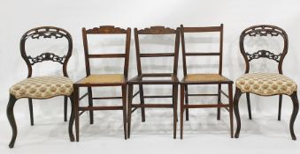 Pair of Victorian mahogany salon chairswith serpentine fronts, cabriole supports and three