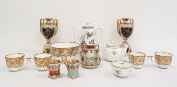 19th century continental porcelain part teaset with white ground decorated with gilt scrolls,