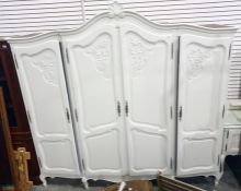 White painted four-door armoire raised on cabriole supports, 220cm x 213cm