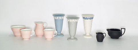 Three various Wedgwood porcelain Queensware vases, a Wedgwood bone china white and pink milk jug,