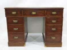 19th century mahogany desk with red leather inset top, nine assorted drawers, on plinth base,
