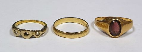 9 ct gold wedding band, 18 ct dress ring and a gold coloured ring