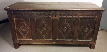 18th century oak coffer, the rectangular top with moulded edge, four front panels with diamond-