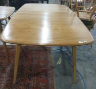 Light elm Ercol extending dining table and six beech and elm stickback Ercol chairs(7) Condition