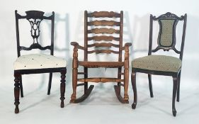 Oak ladderback rush-seated rocking chairand two further chairs(3)