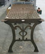 Cast iron garden table with woven lattice style decoration to the top with two cast patterned ends