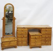 20th century pine bedroom furniturecomprising dressing table, bedside chest of three drawers,