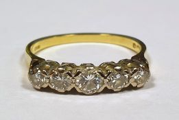 18 ct gold and five stone diamond ringCondition Reportthe larger stone is approx 3 mm the rest
