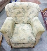 Armchair in green loose covers