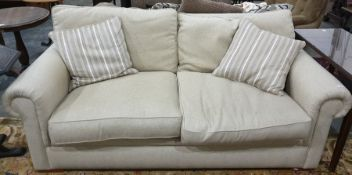 Modern cream fabric two seater sofa, with two scatter cushionsCondition Reportwidth 213 cms x 86 cms
