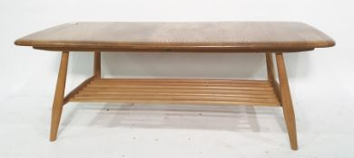 Light elm Ercol oblong coffee tableon beech supports and spindle undertier, 105cm x 36cm