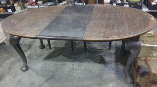 Early 20th century oak D-end extending dining tableon cabriole supports