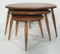 Nest of three light elm Ercol 'Pebble' tables