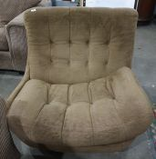 Mid twentieth century Englander designer swivel chair, upholstered in brown with buttonbackCondition