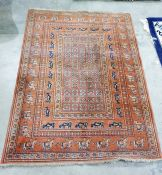 Orange pure new wool rug of the Pazyryk Samarkand pattern, in the Eastern-style featuring stylised