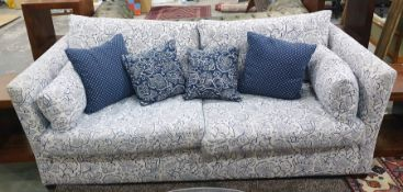 Three-seater sofawith white ground foliate patterned upholstery with scatter cushions Condition