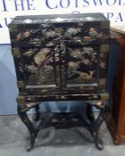 20th century Chinese-style black lacquer and mother-of-pearl decorated cabinet, the pagoda lift