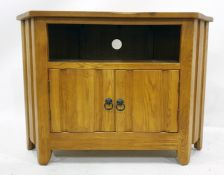 20th century oak television stand with open recess above two cupboard doors