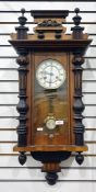 Vienna regulator style wall clock in elaborately carved case with brass bezel face, white enamelled,
