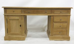 Modern oak desk, the rectangular top with moulded edge, assorted drawers and cupboard doors, the