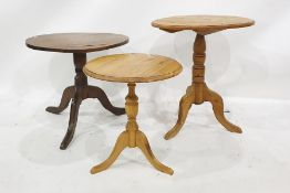 Three circular occasional centre tablesincluding elm-topped table on turned supports and cabriole